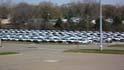 White Trucks Filling the Parking Lot